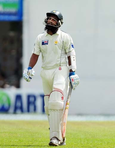 Mohammad Yousuf walks back to the pavilion following his dismissal during the first day of the second Test match between Pakistan and Sri Lanka at The P. Saravanamuttu Stadium in Colombo. (AFP Photo)