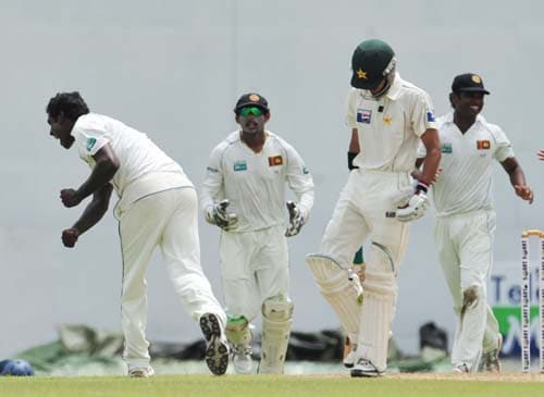 Angelo Mathews celebrates the dismissal of Fawad Alam with teammates during the first day of the second Test match between Pakistan and Sri Lanka at The P. Saravanamuttu Stadium in Colombo. (AFP Photo)
