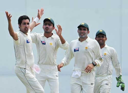 Umar Gul celebrates with teammate Fawad Alam, Misbah-ul-Haq and Kamran Akmal for the dismissal of Rangana Herath during the second day of the second Test match between Pakistan and Sri Lanka at The P. Saravanamuttu Stadium in Colombo. (AFP Photo)