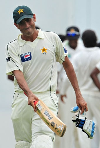 Younus Khan walks back to the pavilion following his dismissal during the third day of the second Test match between Pakistan and Sri Lanka at The P. Sara Oval Stadium in Colombo. (AFP Photo)