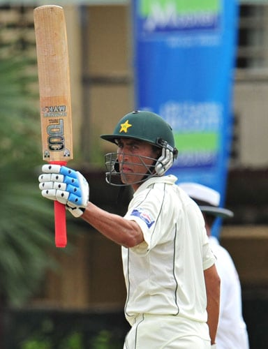 Younus Khan raises his bat to the crowd after scoring a half-century during the third day of the second Test match between Pakistan and Sri Lanka at The P. Sara Oval Stadium in Colombo. (AFP Photo)