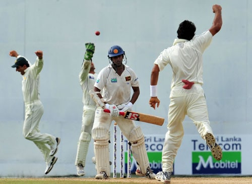 Abdur Rauf celebrates with teammates Misbah-ul-Haq and wicketkeeper Kamran Akmal the dismissal of Malinda Warnapura during the third day of the second Test match between Pakistan and Sri Lanka at The P. Sara Oval Stadium in Colombo. (AFP Photo)