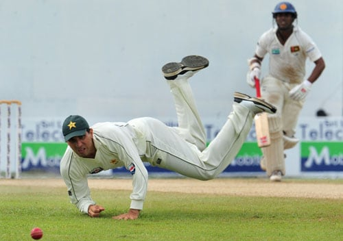 Misbah-ul-Haq attempts to field a ball during the third day of the second Test match between Pakistan and Sri Lanka at The P. Sara Oval Stadium in Colombo. (AFP Photo)