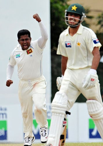 Rangana Herath celebrates the dismissal of Fawad Alam during the third day of the second Test match between Pakistan and Sri Lanka at The P. Sara Oval Stadium in Colombo. (AFP Photo)