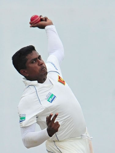 Rangana Herath delivers the ball during the third day of the second Test match between Pakistan and Sri Lanka at The P. Sara Oval Stadium in Colombo. (AFP Photo)