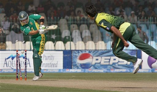 South African Herschelle Gibbs, left, is bowled by Pakistan pacer Rao Iftikhar during their fifth one-day international cricket match at Gaddafi Stadium in Lahore, Pakistan on Monday.