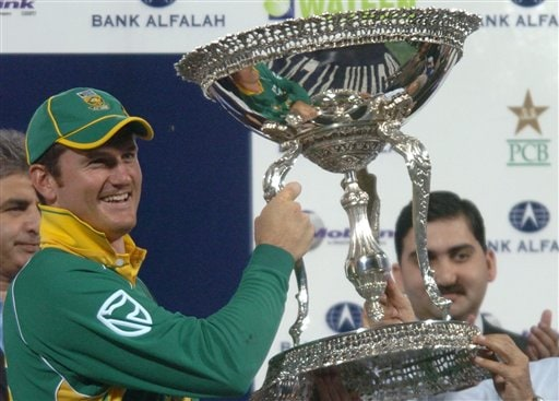 South African skipper Graeme Smith holds winning trophy during the awarding ceremony on the end of fifth one-day international cricket match at Gaddafi Stadium in Lahore, Pakistan on Monday.