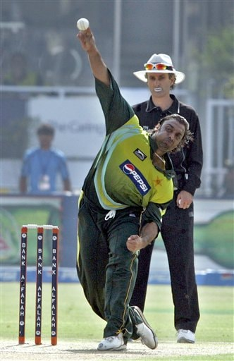 Pakistan pacer Shoaib Akhtar, front, bowls to South African batsman Jacques Kallis, unseen, during their fifth one-day international cricket match at Gaddafi Stadium in Lahore, Pakistan on Monday.