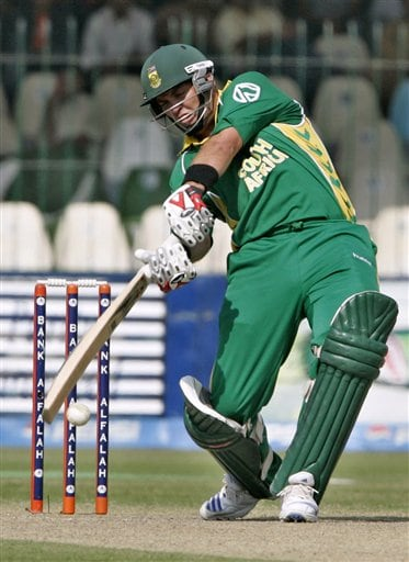 South African batsman Jacques Kallis plays a shot off Pakistan pacer Shoaib Akhtar, unseen, during their fifth one-day international cricket match at Gaddafi Stadium in Lahore, Pakistan on Monday.