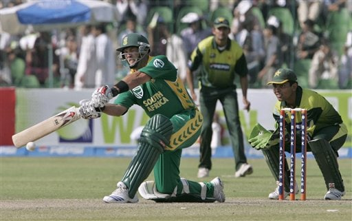 South African batsman Jacques Kallis, left, plays a shot as Pakistani wicket keeper Kamran Akmal looks on during their fifth one-day international cricket match at Gaddafi Stadium in Lahore, Pakistan on Monday.