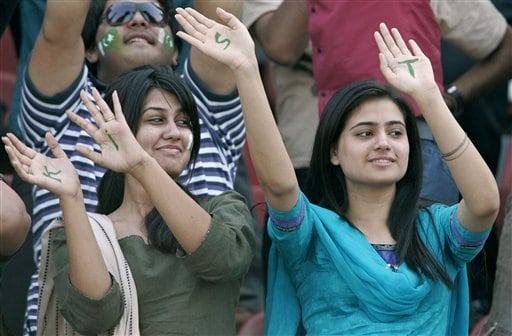 Pakistani girls wave as they watch the fifth one-day international cricket match between Pakistan and South Africa at Gaddafi Stadium in Lahore, Pakistan on Monday.