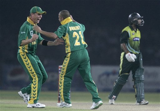 South African Jean Paul Duminy, center, celebrates with teammate Johan Botha after taking the wicket of Pakistani batsman Mohammad Yousuf during their fifth one-day international cricket match at Gaddafi Stadium in Lahore, Pakistan.