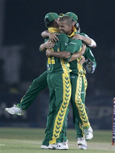 South African Jean Paul Duminy, center, celebrates with teammates after taking the wicket of Pakistani batsman Mohammad Yousuf, unseen, during their fifth one-day international cricket match at Gaddafi Stadium in Lahore, Pakistan.