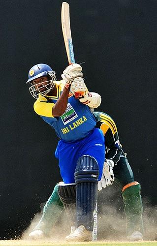 Muttiah Muralitharan plays a shot during the first One-Day International match between Sri Lanka and Pakistan in Dambulla. (AFP Photo)