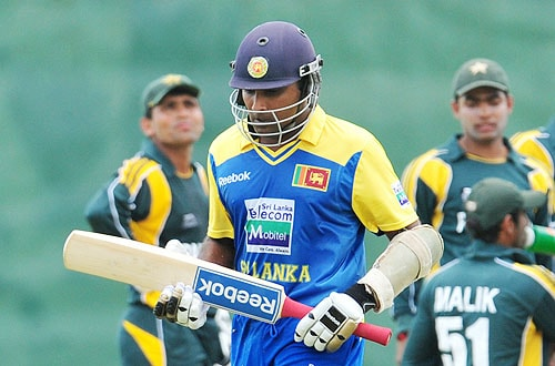 Mahela Jayawardene walks back to the pavilion after his dismissal during the first One-Day International match between Sri Lanka and Pakistan in Dambulla. (AFP Photo)