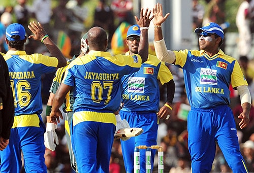 Sanath Jayasuriya celebrates with his teammates after dismissing Fawad Alam during the first One-Day International match between Sri Lanka and Pakistan in Dambulla. (AFP Photo)