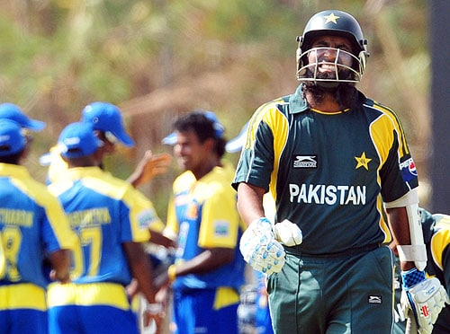 Mohammad Yousuf walks back to the pavilion after his dismissal during the first One-Day International match between Sri Lanka and Pakistan in Dambulla. (AFP Photo)