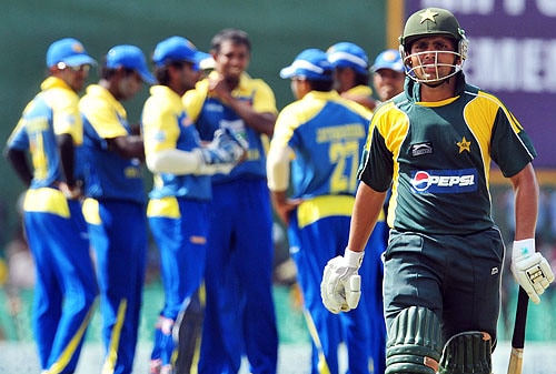 Kamran Akmal walks back to the pavilion after being dismissed during the first One-Day International match between Sri Lanka and Pakistan in Dambulla. (AFP Photo)