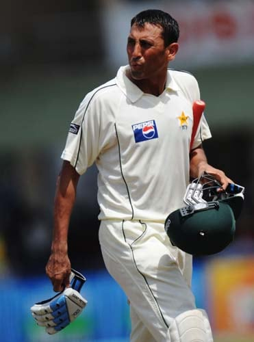 1. Younus Khan walks back to the pavilion following his dismissal during the second day of the first Test match between Pakistan and Sri Lanka at The Galle International Stadium in Galle on July 5, 2009. (AFP Photo)