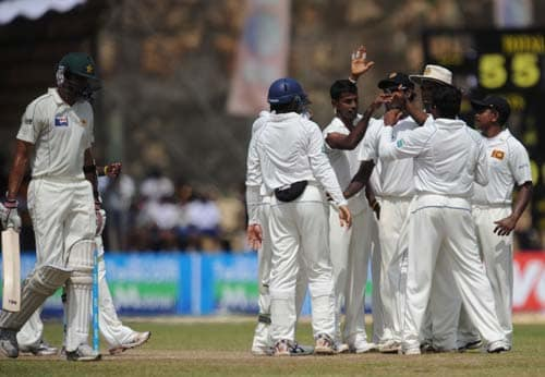 3. Nuwan Kulasekara is congratulated by his teammates after dismissing Abdur Rauf during the second day of the first Test match between Pakistan and Sri Lanka at The Galle International Stadium in Galle. (AFP Photo)