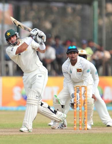 7. Misbah-ul-Haq hits a stroke while Tillakaratne Dilshan looks on during the second day of the first Test match between Pakistan and Sri Lanka at The Galle International Stadium in Galle. (AFP Photo)