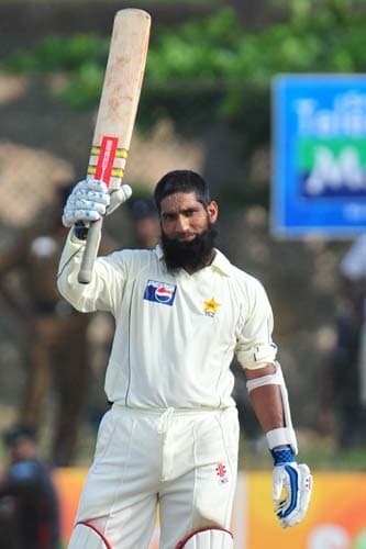 9. Mohammad Yousuf raises his bat in celebration after scoring a century during the second day of the first Test match between Pakistan and Sri Lanka at The Galle International Stadium in Galle. (AFP Photo)