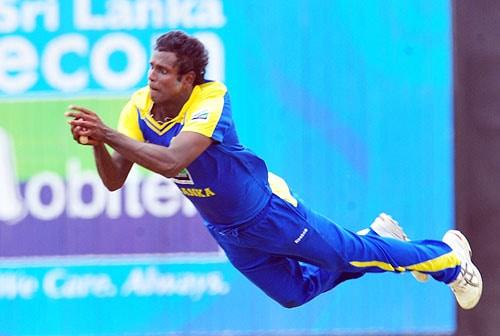 Angelo Mathews takes a catch and dismisses Fawad Alam during the third One-Day International match between Sri Lanka and Pakistan at The Rangiri Dambulla International Cricket stadium in Dambulla. (AFP Photo)
