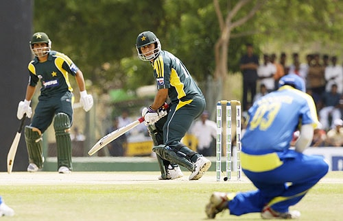 Nasir Jamshed looks on as he is caught in the slips by Thilan Samaraweera, right, in the third One-day international cricket match in Dambulla. (AP Photo)