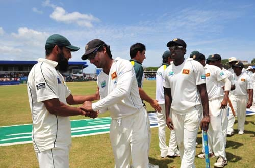 Mohammad Yousuf is congratulated by Kumar Sangakkara at the conclusion of the fourth day of the first Test match between Pakistan and Sri Lanka at The Galle International Stadium in Galle on July 7, 2009. (AFP Photo)