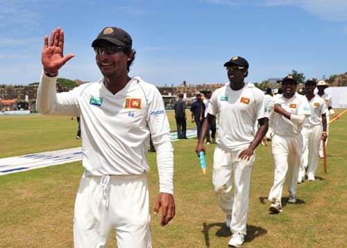Kumar Sangakkara gestures following his team's victory as they walk off the pitch at the conclusion of the fourth day of the first Test match between Pakistan and Sri Lanka at The Galle International Stadium in Galle. (AFP Photo)