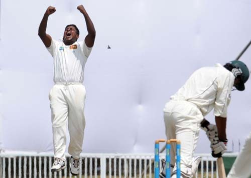 Sri Lankan cricketer Rangana Herath celebrates his team's victory at the conclusion of the fourth day of the first Test match between Pakistan and Sri Lanka at The Galle International Stadium in Galle. (AFP Photo)