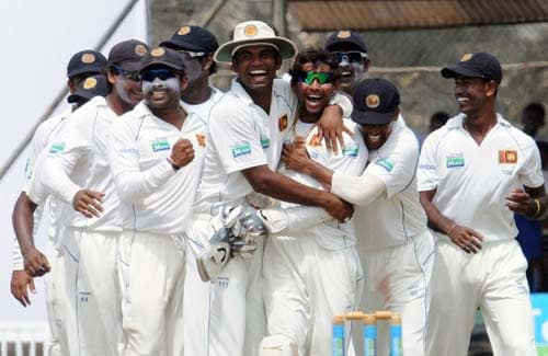 Sri Lankan cricketers celebrate the dismissal of Misbah-ul-Haq during the fourth day of the first Test match between Pakistan and Sri Lanka at The Galle International Stadium in Galle. (AFP Photo)