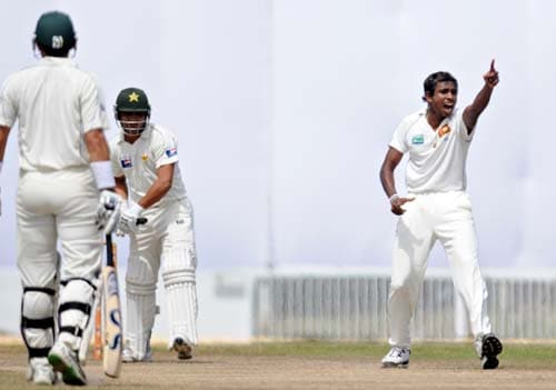 Thilan Thushara celebrates the dismissal of Kamran Akmal during the fourth day of the first Test match between Pakistan and Sri Lanka at The Galle International Stadium in Galle. (AFP Photo)