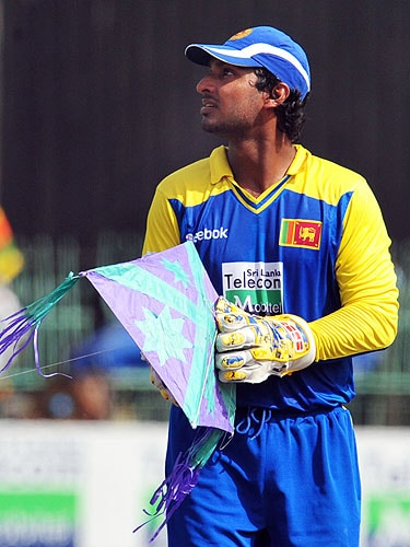 Kumar Sangakkara picks up a kite after it landed on the grounds during the fifth and final One-Day International match between Sri Lanka and Pakistan at The R Premadasa Stadium in Colombo. (AFP Photo)