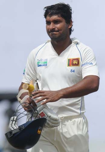 Kumar Sangakkara walks back to the pavilion after his dismissal during the first day of the first Test match between and Sri Lanka at The Galle International Stadium in Galle on July 4, 2009. (AFP Photo)
