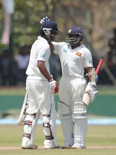 Tharanga Paranavitana is congratulated by his teammate Mahela Jayawardene after scoring a half-century during the first Test match between and Sri Lanka at The Galle International. (AFP Photo)