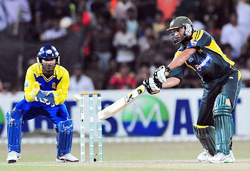 Shahid Afridi is watched by Kumar Sangakkara as he plays a stroke during a Twenty20 match between Sri Lanka and Pakistan in Colombo. (AFP Photo)