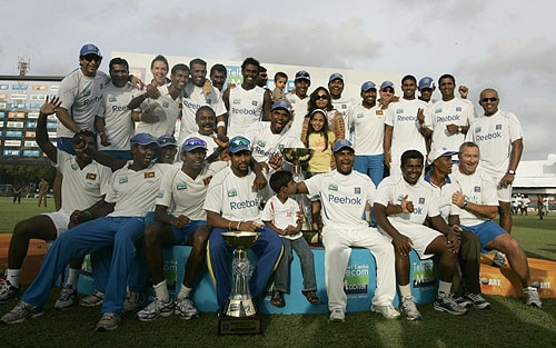 Sri Lankan cricket team members along with the wife of Chaminda Vaas, Wasana, center back row, pose for a photograph at the end of the final Test match between Sri Lanka and Pakistan in Colombo on July 24, 2009. (AP Photo)