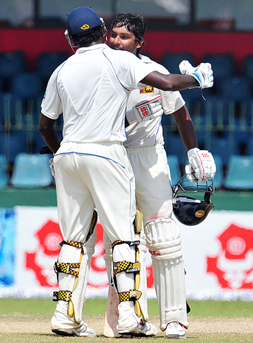 Kumar Sangakkara is congratulated by teammate Angelo Mathews after he scored a century during the final day of the third Test match between Sri Lanka and Pakistan at The Sinhalese Sports Club in Colombo. (AFP Photo)