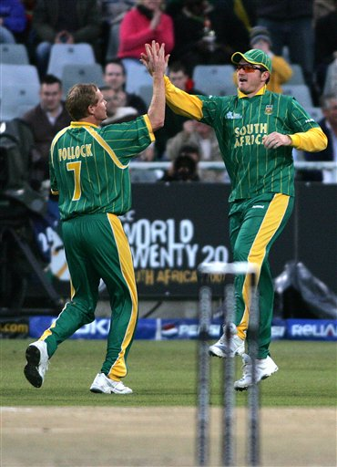 South Africa's Shaun Pollock, left, celebrates with his teammate Graeme Smith, right, after dismissing Bangladesh's Aftab Ahmed, not seen, during World Twenty 20 cricket Championships at Newlands in Cape Town, South Africa, Saturday Sept 15, 2007.