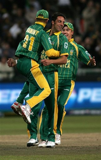 Africa's Johan Van Der Wath, middle, is congratulated by his teammates after dismissing Bangladesh's Shakib Al Hasan, not seen, during World Twenty 20 cricket Championships at Newlands in Cape Town, South Africa, Saturday Sept 15, 2007.