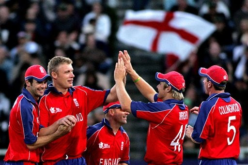England's Andrew Flintoff, 2nd left, celebrates with his teammates after dismissing South Africa's AB. De Villiers, not seen, during World Twenty 20 cricket Championships at Newlands in Cape Town, South Africa, Sunday, Sept. 16, 2007.