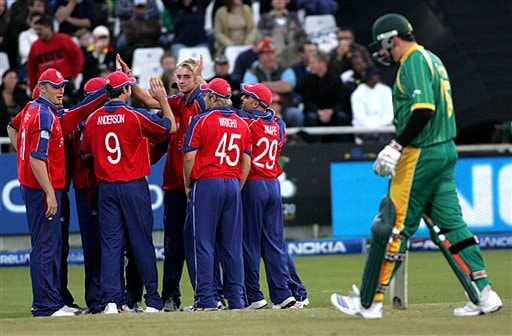 England's Stuart Broad is surrounded by his teammates after dismissing South Africa's Greame Smith during World Twenty 20 cricket Championships at Newlands in Cape Town, South Africa, Sunday, Sept. 16, 2007.