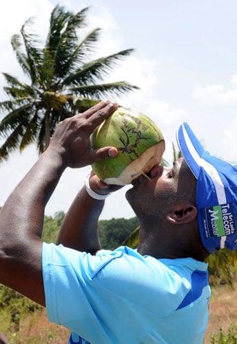 Sanath Jayasuriya drinks a king coconut during a practice session at the Rangiri Dambulla International stadium in Dambulla, Colombo on July 29, 2009. Sri Lanka are set to play five ODIs and a Twenty20 International series against the visiting Pakistan team. (AFP Photo)