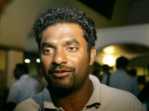 Sri Lankan cricketer Muttaiah Muralitharan reacts upon his arrival at Bandaranayake International Airport in Colombo. After the attacks, the Sri Lanka tour of Pakistan was canceled with immediate effects and the players were called back home. (AP)