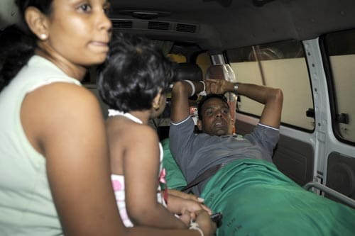 Sri Lankan player Thilan Samaraweera is taken aboard an ambulance on March 04, 2009 accompanied by his wife, Manjula and their daughter, shortly after flying home from Pakistan where the Sri Lankan team was ambushed by gunmen just before entering a cricket stadium in Lahore. (AFP)