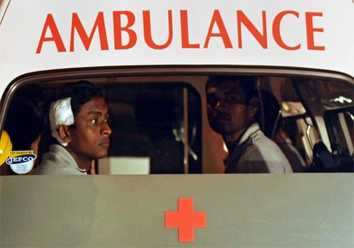 Sri Lankan crickets Ajantha Mendis and Tharanga Paranavithana get into an ambulance shortly after reaching Colombo on March 04. The Sri Lankan team was attacked by unidentified gunmen some fifty meters away from Gaddafi stadium in Lahore, Pakistan. (AFP)