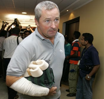 Assistant coach of the Sri Lankan cricket team Paul Farbrace arrives at Bandaranayake International Airport in Colombo. He was in the same bus that was attacked by a dozen of gunmen while the team was about to reach the Gaddafi stadium for the third day of their 2nd test match in Pakistan. (AP)
