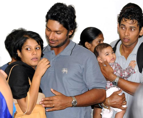 Sri Lankan cricketer Kumar Sangakkara hugs his wife Yehali and Thillakeratne Dilshan holds his son upon their return to the island. After the attacks, the Sri Lankan cricket players were evacuated immediately. A military army helicopter airlifted the players to Lahore airport. (AFP)