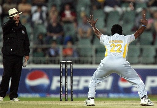 Sri Lanka's bowler Chaminda Vaas, right, appeals successfully for LBW to umpire Mark Benson of England, left, to dismiss Bangladesh's batsman Nazimuddin, unseen, during their Super Eight Twenty20 World Championship cricket match at the Wanderers Stadium in Johannesburg, South Africa, Tuesday, Sept. 18, 2007.